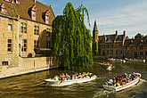 heritage stock photography | Belgium, Bruges, Tourist sightseeing boats on canal, image id 8-740-907