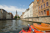 sightseeing boat on canal stock photography | Belgium, Bruges, Tourist sightseeing boat on canal, image id 8-740-918