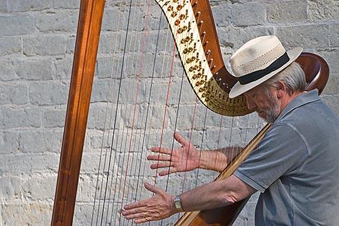 image 8-741-2226 Belgium, Bruges, Man playing harp, seated