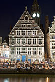travel stock photography | Belgium, Ghent, Gabled guild house on Graslei canal at night, image id 8-743-2321