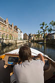 sightseeing boat on canal stock photography | Belgium, Ghent, Sightseeing boat on canal, image id 8-743-2450