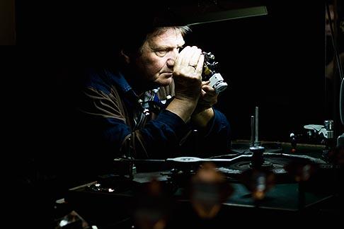 image 8-745-2712 Belgium, Antwerp, Jeweler examining a diamond at the Diamond Museum
