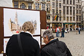 horizontal stock photography | Belgium, Brussels, City of Brussels Museum, Grand Place, women looking at art display, image id 8-746-2716