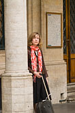 vertical stock photography | Belgium, Brussels, Woman standing by column, Town Hall, image id 8-747-2839