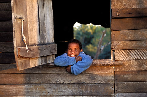 image 6-106-5 Belize, Cayo District, Young boy in window