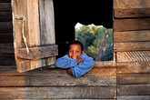 accommodation stock photography | Belize, Cayo District, Young boy in window, image id 6-106-5