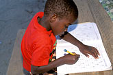 horizontal stock photography | Belize, Garifuna boy with schoolwork, image id 6-46-21