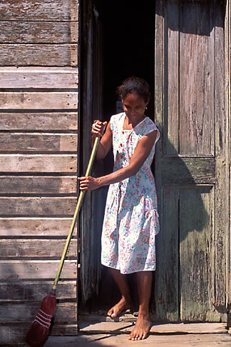 image 6-75-31 Belize, Monkey River, Woman sweeping house steps