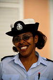 smiling woman stock photography | Bermuda, St. George, Policewoman, image id 1-600-12