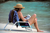 pensive stock photography | Bermuda, Woman reading on the beach, image id 1-600-8