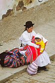 backpack stock photography | Bolivia, Lake Titicaca, Aymara woman and child, Copacabana, image id 3-112-22
