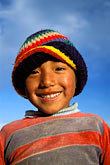 hat stock photography | Bolivia, La Paz, Young boy on hillside above the city, image id 3-120-5