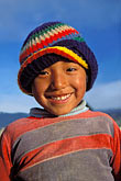 hat stock photography | Bolivia, La Paz, Young boy on hillside above the city, image id 3-120-7