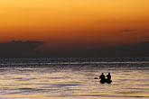 canoes stock photography | Bolivia, Lake Titicaca, Boaters on the lake at sunset, Copacabana, image id 3-93-23