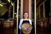 historical district stock photography | California, Sacramento, Old Sacramento, Woman at candy shop, image id 1-652-37