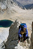 hazard stock photography | California, Mt Whitney, Climber on East Buttress above Iceberg Lake, image id 2-113-25