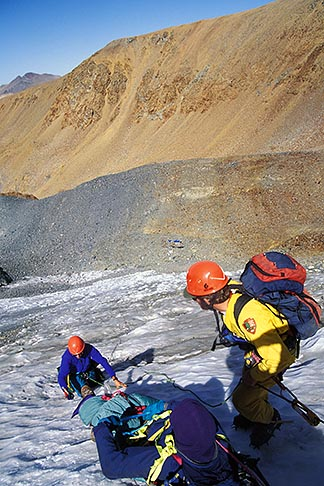 image 2-149-25 California, Sierra Nevada, Lowering injured climber on Dana Glacier