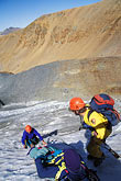 usa stock photography | California, Sierra Nevada, Lowering injured climber on Dana Glacier, image id 2-149-25