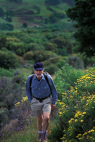 image 2-37-9 California, Mt Diablo, Hiker on Mt Olympia, with Spring flowers