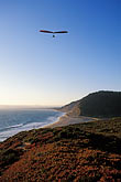 evening stock photography | California, Santa Cruz County, Hang gliding on the coast , image id 2-630-40