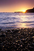 pacific ocean at sunset stock photography | California, Point Arena, Sunset from beach at Arena Cove, image id 4-795-95