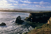 bluff stock photography | California, Point Arena, Rock arch at mouth of Garcia River, image id 4-796-22