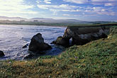 seashore stock photography | California, Point Arena, Rock arch at mouth of Garcia River, image id 4-796-23