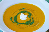 colour stock photography | Food, Carrot ginger rosemary soup with sour cream and spinach coulis, image id 4-797-86