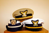head covering stock photography | California, Point Arena, Coast Guard House, Naval caps, image id 4-800-15