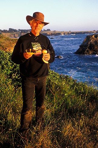 image 4-835-5 California, Mendocino, Man with wild mushrooms