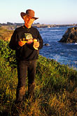 head covering stock photography | California, Mendocino, Man with wild mushrooms, image id 4-835-5