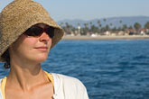 horizontal stock photography | California, Santa Barbara, Young woman with straw hat, image id 4-930-5430