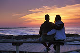 couple watching sunset stock photography | California, Pacific Grove, Asilomar State Beach, sunset, image id 4-987-21