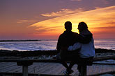 couple watching sunset stock photography | California, Pacific Grove, Painted wall, downtown, image id 4-987-47