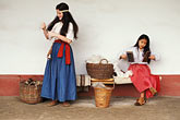 two girls stock photography | California, Missions, Spinning & carding wool, La Purisima Mission State Park, image id 5-135-12