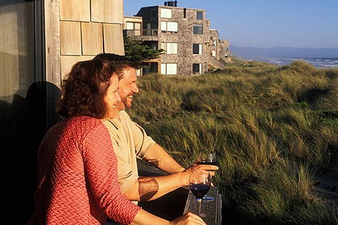 image 5-671-23 California, Santa Cruz County, Pajaro Dunes, Couple on balcony