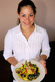 dine stock photography | California, Moss Landing, Waitress with paella, image id 5-672-73