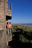 woman on beach stock photography | California, Santa Cruz County, Pajaro Dunes, Couple on balcony, image id 5-673-20