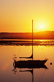 calm stock photography | California, Morro Bay, Sailboat at sunset, image id 6-470-26