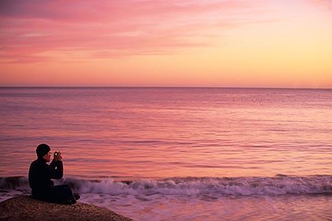 image 7-600-86 California, Santa Cruz, Man photographing at sunset