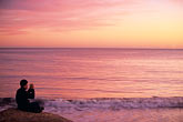 coast stock photography | California, Santa Cruz, Man photographing at sunset, image id 7-600-86