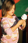 eat stock photography | California, Santa Cruz, Santa Cruz Beach Boardwalk, girl with ice cream cone, image id 7-601-73