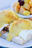 eating breakfast stock photography | California, Santa Cruz, Eggs Benedict with Salmon, image id 7-602-19