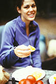 one woman only stock photography | California, Big Sur, Eating an orange, image id S4-220-7