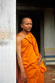 vertical stock photography | Cambodia, Angkor Wat, Buddhist monk, image id 0-400-68