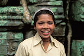 smiling woman stock photography | Cambodia, Angkor Wat, Cambodian guide, Ta Prohm, image id 0-401-38