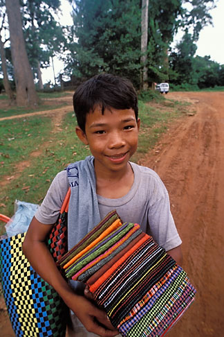 image 0-402-15 Cambodia, Siem Reap, Boy with cloth, Banteay Srei