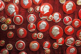 red stock photography | China, Buttons of Chairman Mao at street stall, image id 4-103-3