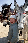donkey stock photography | China, Gansu Province, Young Hui boy, Farmer