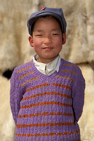image 4-117-1 China, Gansu Province, Young boy and lambskins, Linxia